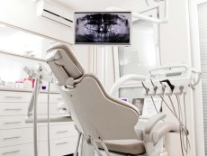Modern dentist office. Place for beautiful smile. Modern dental practice. Dental chair and other accessories used by dentists